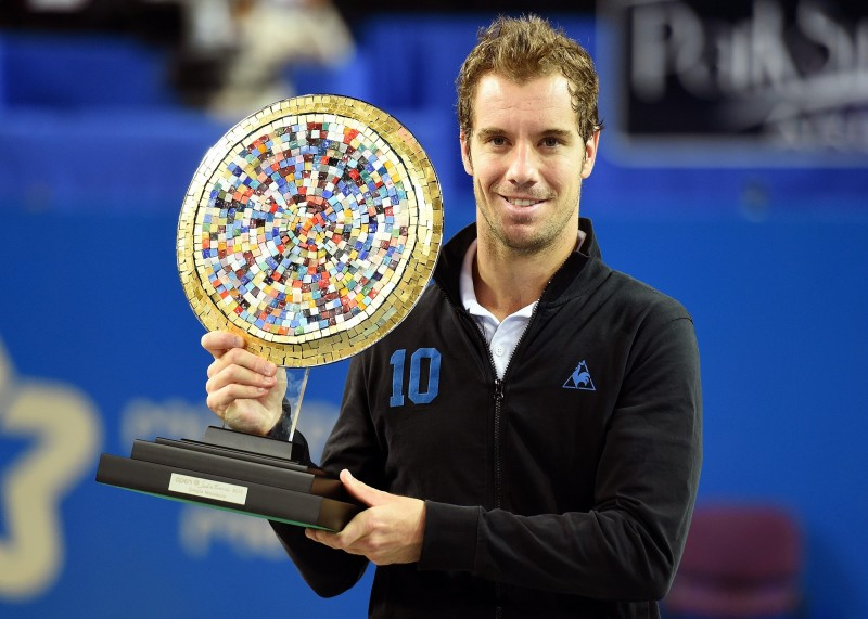 French tennis player Richard Gasquet poses with his trophy after winning over Polish Jerzy Janowicz in the final tennis match of the Open Sud de France world tour ATP Series, on February 8, 2015 in Montpellier, southern France AFP PHOTO / PASCAL GUYOT