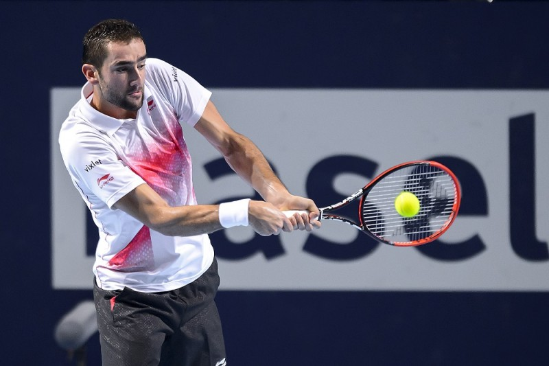 Croatia's Marin Cilic returns the ball to Spain's Rafael Nadal during their quarter-final match at the Swiss Indoors tennis tournament on October 30, 2015 in Basel, northern Switzerland. AFP PHOTO / FABRICE COFFRINI / AFP / FABRICE COFFRINI