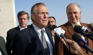 (FILES) - A file picture taken on December 30, 2005 shows the leader of the Iraqi National Congress Ahmed Chalabi (R) listening to ex-US secretary of defense Donald Rumsfeld as he spoke to the media prior to a meeting of the new Governing Council in the Iraqi capital Baghdad. Chalabi, who was blamed for providing false intelligence on weapons of mass destruction to justify the US led invasion of Iraq, died of a heart attack on November 3, 2015.   AFP PHOTO / RABIH MOGHRABI