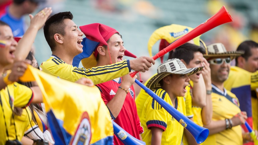 Colombian fans cheer as their team warms up for their FIFA Women's World Cup Round of 16 football match against the United States at Commonwealth Stadium in Edmonton, Canada on June 22, 2015.   AFP PHOTO/GEOFF ROBINS