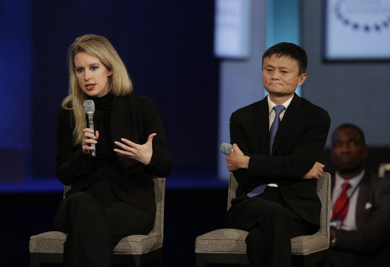 Theranos Founder and CEO Elizabeth Holmes (L) speaks next to Alibaba Group Executive Chairman Jack Ma during the Clinton Global Initiative annual meeting in New York on September 29, 2015. AFP PHOTO/JOSHUA LOTT