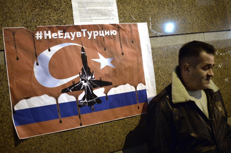 2745616 11/24/2015 A participant of protests outside the Turkish Embassy in Moscow against the Turkish Air Force actions that downed a Russian Su-24 jet. Ramil Sitdikov/Sputnik