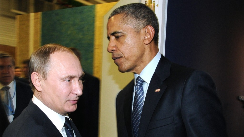 2748933 11/30/2015 Presidents Vladimir Putin (left) of Russia and Barack Obama (center) of the United States taking part in the 2015 Paris Climate Conference - United Nations Framework Convention on Climate Change, November 30, 2015. Michael Klimentyev/Sputnik