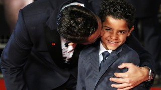 UNITED KINGDOM, London: Cristiano Ronaldo and his son Cristiano Ronaldo Junior attend the world premiere of the documentary Ronaldo at Vue West End cinema at Leicester Square, London on November 9, 2015.  - CITIZENSIDE/RICHARD GOLDSCHMIDT