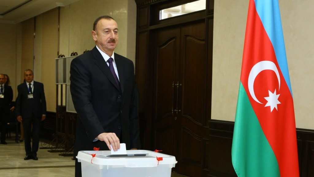 BAKU, AZERBAIJAN - NOVEMBER 1: Azerbaijani president Ilham Aliyev casts his vote during the parliamentary elections at a polling station in Baku, Azerbaijan on November 1, 2015. Resul Rehimov / Anadolu Agency