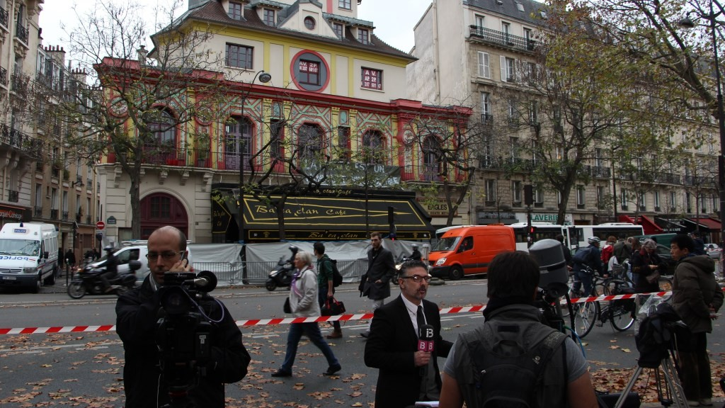 PARIS, FRANCE - NOVEMBER 19: Reporters broadcast live in front of Bataclan concert hall, where terrorists killed dozens of people, in Paris, France on November 19, 2015 following Paris terror attacks. Bilal Muftuoglu / Anadolu Agency