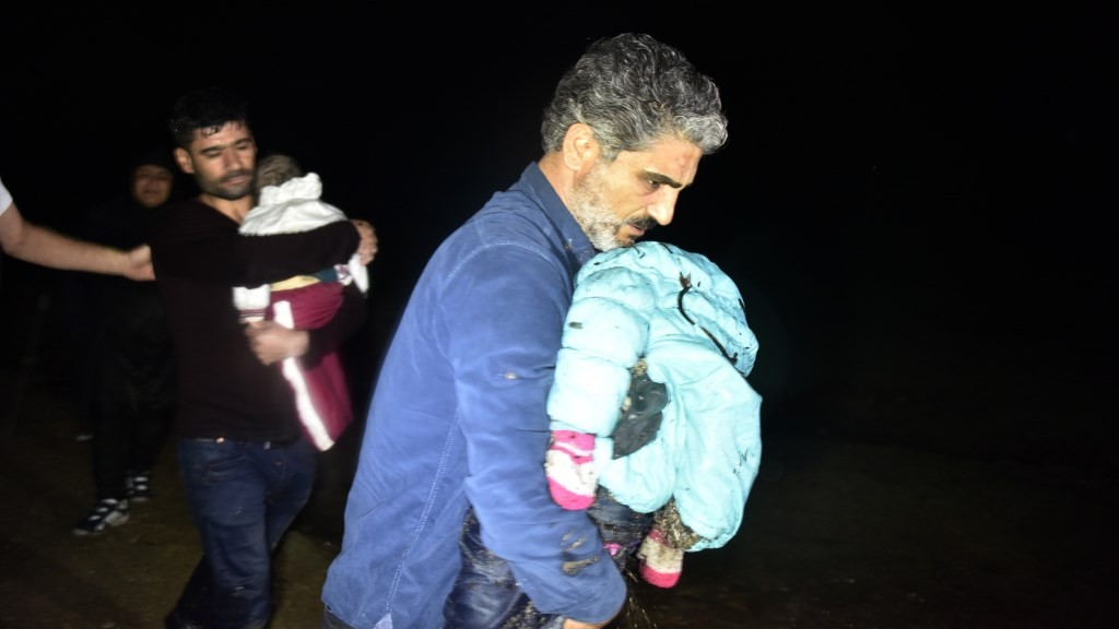 MUGLA, TURKEY - NOVEMBER 26:  Dead bodies of two drowned refugee children, Dlven Halil Huseyin (1) and Beren Halil Huseyin (4), are carried after their boat was sunk during their journey to Europe, at the shores of Mugla, Turkey on November 26, 2015. Ali Balli / Anadolu Agency