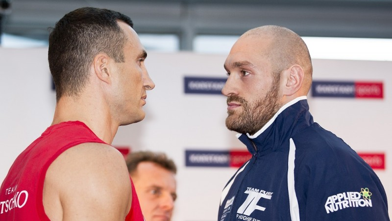 ESSEN, GERMANY  - NOVEMBER 27: Ukrainian Heavyweight World Champion Wladimir Klitschko (L) and his challenger Britain's Tyson Fury (R) pose for a face-off during an official weigh-in in Essen, western Germany on November 27, 2015. World heavyweight champion Klitschko will defend his IBF, WBA and IBO titles against British challenger Tyson Fury in Duesseldorf on November 28, 2015. Marianne Mueller / Anadolu Agency