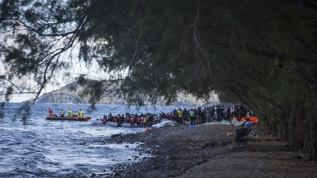 LESBOS ISLAND, GREECE - NOVEMBER 29: Refugees hoping to cross into Europe, arrive on the shore of Lesbos Island, Greece after crossing the Aegean sea from Turkey on November 29, 2015. Ozge Elif Kizil / Anadolu Agency