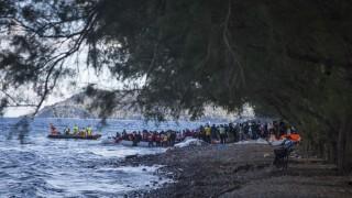 LESBOS ISLAND, GREECE - NOVEMBER 29: Refugees hoping to cross into Europe, arrive on the shore of Lesbos Island, Greece after crossing the Aegean sea from Turkey on November 29, 2015. Ozge Elif Kizil / Anadolu Agency