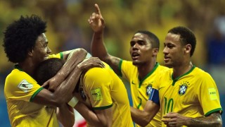 (L to R) Brazil's Willian, Renato Augusto, Douglas Costa and Neymar Jr. celebrate after scoring against Peru during their Russia 2018 FIFA World Cup South American Qualifiers football match, in Salvador de Bahia, on November 17, 2015.    AFP PHOTO / CHRISTOPHE SIMON