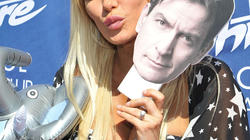 LAS VEGAS, NV - MAY 25:  Model Crystal Hefner holds a cutout picture of Charlie Sheen's face as she appears at the Sapphire Pool & Day Club's Memorial Day weekend celebration on May 25, 2013 in Las Vegas, Nevada.  (Photo by Jeff R. Bottari/Getty Images)