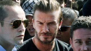Former England international football player and UNICEF Goodwill Ambassador David Beckham arrives at the start of a visit to Nepal for the United Nations Children's Fund (UNICEF) in Kathmandu on November 6, 2015. Beckham is scheduled to take part in documentary and play in a charity football match. AFP PHOTO / Rajendra KC