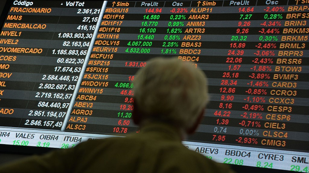 A man is seen at the Stocks Exchange headquarters in downtown Sao Paulo Brazil on September 22, 2015. The dollar runs higher on Tuesday and passes the historical maximum of R$ 4.The high should market concerns with votes in Congress and with the possibility of the Federal Reserve the central bank of the United States raise interest rates this year. AFP PHOTO / Nelson ALMEIDA
