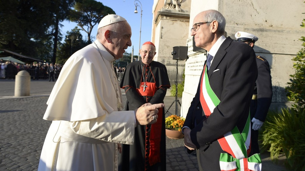 """This handout picture released by the Vatican press office shows the Prefect of Milan and new commissioner of Rome, Francesco Paolo Tronca (R) talking with Pope Francis as he arrives to lead a mass on the occasion of All Saints' day on November 1, 2015 at Campo di Verano cemetery in Rome. Tronca will substitute Mayor Ignazio Marino until elections for a new mayor next spring after 26 councillors quit on October 23, 2015 ended prematurely the Rome's mayor mandat.    AFP PHOTO / OSSERVATORE ROMANO/HO  RESTRICTED TO EDITORIAL USE - MANDATORY CREDIT """"AFP PHOTO / OSSERVATORE ROMANO"""" - NO MARKETING NO ADVERTISING CAMPAIGNS - DISTRIBUTED AS A SERVICE TO CLIENTS"""