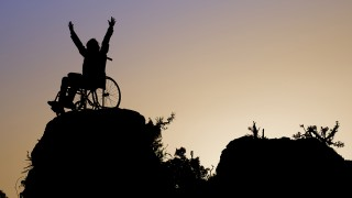 Silhouette of girl on a wheelchair