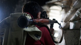 ALEPPO, SYRIA - JANUARY 31: A 16th division member of Free Syrian Army (FSA) is seen with a bazooka during the attacks against Assad regime forces in Ashrafieh district of Aleppo, Syria on January 31, 2015. Salih Mahmud Leyla / Anadolu Agency