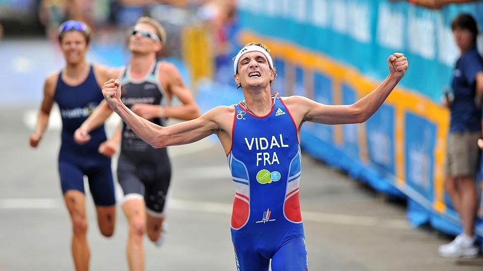 MOOLOOLABA, AUSTRALIA - MARCH 24:  In this handout image provided by the International Triathlon Union, France?s Laurent Vidal celebrates his first ITU World Cup victory at the 2012 Mooloolaba ITU Triathlon World Cup on March 24, 2012 in Mooloolaba, Australia. Sexton went on to finish 5th. (Photo by ITU via Getty Images)