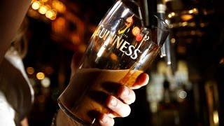 A woman pulls a pint of Guinness beer in London, on May 9, 2008. Diageo, the alcoholic beverages giant, said Friday it plans to overhaul its Guinness operations in Ireland in a bid to cut costs and boost production of the distinctive black stout. Diageo, the world's biggest maker of alcoholic drinks, said it would close two breweries and renovate its famous St. James's Gate brewery in the centre of Dublin -- where Guinness has been made for the past 250 years. AFP PHOTO/Leon Neal