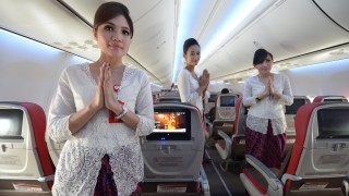 Indonesian air hostess pose inside a Boeing 737-900 plane of the new Indonesian airline Batik Air, a subsidiary of Lion Air is parked at the Soekarno-Hatta airport during the launching ceremony in Tangerang in the outskirt of Jakarta on April 25, 2013. Lion Air, Indonesia's biggest privately owned carrier expanded its service by launching Batik Air, a premium full service international and domestic flights on April 25. With 240 million people, Indonesia is the world's fourth most populous nation, and embraces more than 17,000 islands scattered across 33 provinces. AFP PHOTO / ADEK BERRY / AFP / ADEK BERRY