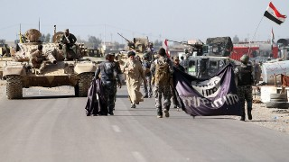 TIKRIT, IRAQ - MARCH 09: Iraqi army forces, supported by Shiite militias haul down the Daesh flags during clashes between Iraqi army forces, supported by Shiite militias, and Daesh (Islamic State of Iraq and the Levant) in Tikrit, Iraq on March 09, 2015. Ali Mohammed  / Anadolu Agency