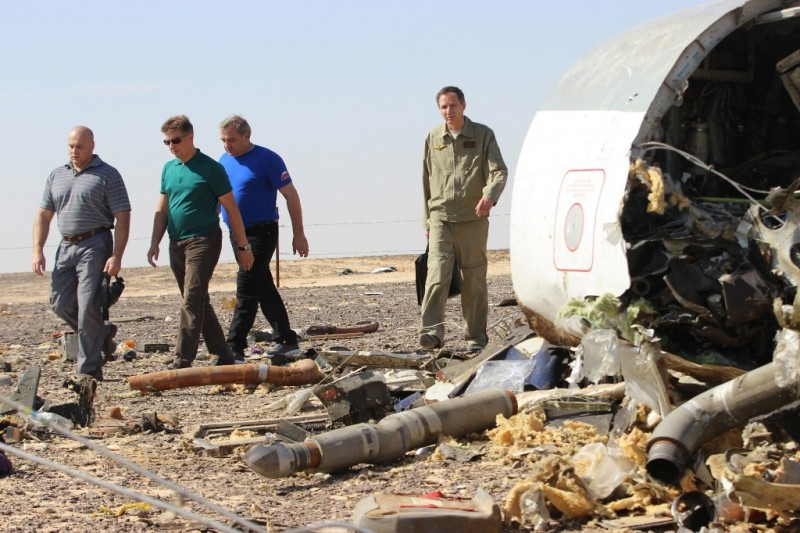 SUEZ, EGYPT - NOVEMBER 01: Russian Minister of Emergency Situations Vladimir Puchkov (3rd L) inspect the crash site of Russian Airliner in Suez, Egypt on November 01, 2015. A Russian Airbus-321 airliner with 224 people aboard crashed in Egypt's Sinai Peninsula on yesterday. According to Egypt's Civil Aviation Authority, the plane had been lost contact with air-traffic controllers shortly after taking off from the Egyptian Red Sea resort city of Sharm el-Sheikh en route to St Petersburg. Mostafa El Shemy / Anadolu Agency