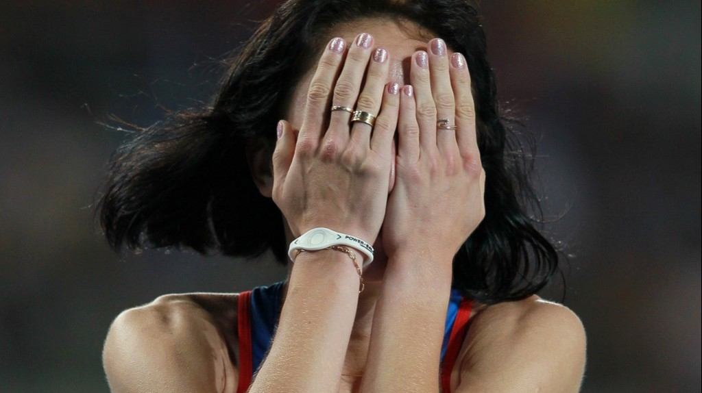 Russian athlete Maria Savinova celebrates her victory after winning a gold medal in the 800-meters race at the World Championships in Athletics 2011 in Daegu.