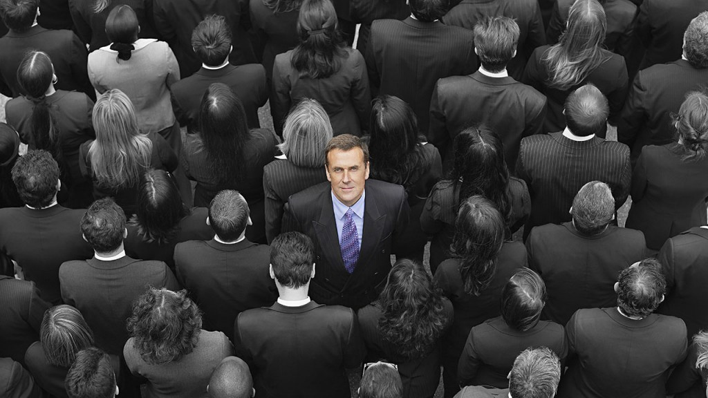 High angle view of a businessman standing amidst businesspeople