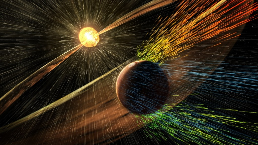 """This NASA image released November 5, 2015 shows an artist's rendering of a solar storm hitting Mars and stripping ions from the planet's upper atmosphere. Mars may once have supported life but is now a cold, dry planet, and scientists said Thursday that a stormy sun likely accelerated the loss of its atmosphere. In fact, researchers believe the thick, protective atmosphere that allowed ancient Mars to be warm and wet billions of years ago may have disappeared far earlier in its history than previously thought. Data from MAVEN, an unmanned spacecraft that has been circling Mars for the past year, was published in scientific studies, including four in the journal Science and 44 more in Geophysical Research Letters. MAVEN, which stands for Mars Atmosphere and Volatile Evolution, launched in 2013 and began orbiting the Red Planet in September 2014. AFP PHOTO/NASA/GSFC  =RESTRICTED TO EDITORIAL USE- MANDATORY CREDIT """"AFP PHOTO / NASA/GSFC"""" -NO MARKETING NO ADVERTISING CAMPAIGNS - DISTRIBUTED AS A SERVICE TO CLIENTS ="""