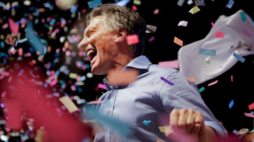 "Photo released by Cambiemos press office of the Head of Government of the Autonomous City of Buenos Aires and candidate for the Cambiemos (Let's Change) party, Mauricio Macri celebrating at the Cambiemos (Let's Change) party headquarters in Buenos Aires on November 22, 2015, after getting early results of the presidential run-off election in Argentina. Argentina's conservative president-elect Mauricio Macri promised a ""marvelous"" new era was starting for the country after he won a runoff election on Sunday. AFP PHOTO/ Cambiemos / AFP / CAMBIEMOS / HO"