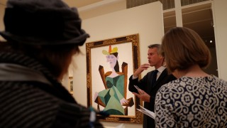 """""""Femme assise sur une chaise"""" by Spanish artist Pablo Picasso is pictured during Sotheby's press preview of the Autumn Evening Auctions in New York on October 30, 2015.  AFP PHOTO/JEWEL SAMAD= MANDATORY MENTION OF THE ARTIST UPON PUBLICATION ="""
