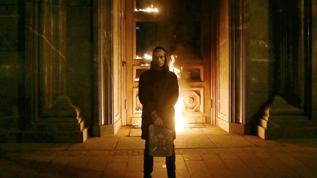 Russian artist Pyotr Pavlensky poses after setting fire to the doors of the headquarters of the FSB security service, the successor to the KGB, in central Moscow early on November 9, 2015. Russian authorities on November 9 detained a performance artist best known for nailing his scrotum to Red Square after he torched the doors of the headquarters of the FSB, the successor to the KGB, Interfax news agency reported. AFP PHOTO / NIGINA BEROEVA