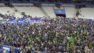 PARIS, FRANCE - NOVEMBER 13:  Spectators wait on the pitch of the during the International Friendly game between France and Germany at Stade de France on November 13, 2015 in Paris, France.  Fans were allowed on the field  following an explosion outside  the Stadium and attacks across Paris claiming the lives of numerous people.   (Photo by Xavier Laine/Getty Images)