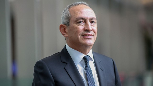 Nassef Sawiris, chief executive officer of Orascom Construction Industries, poses for a photograph after an interview in New York, U.S., on Wednesday, Sept. 5, 2012. Orascom Construction Industries, Egypt?s biggest publicly traded company, said it will build a $1.4-billion fertilizer plant in Iowa, the biggest investment in the state?s history. Photographer: Stephen Yang/Bloomberg via Getty Images