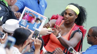 NEW YORK, NY - SEPTEMBER 2: Serena Williams of USA signs autographs to her fans following her match on day three of the 2015 US Open at USTA Billie Jean King National Tennis Center on September 2, 2015 in the Flushing neighborhood of the Queens borough of New York City. (Photo by Jean Catuffe/GC Images)