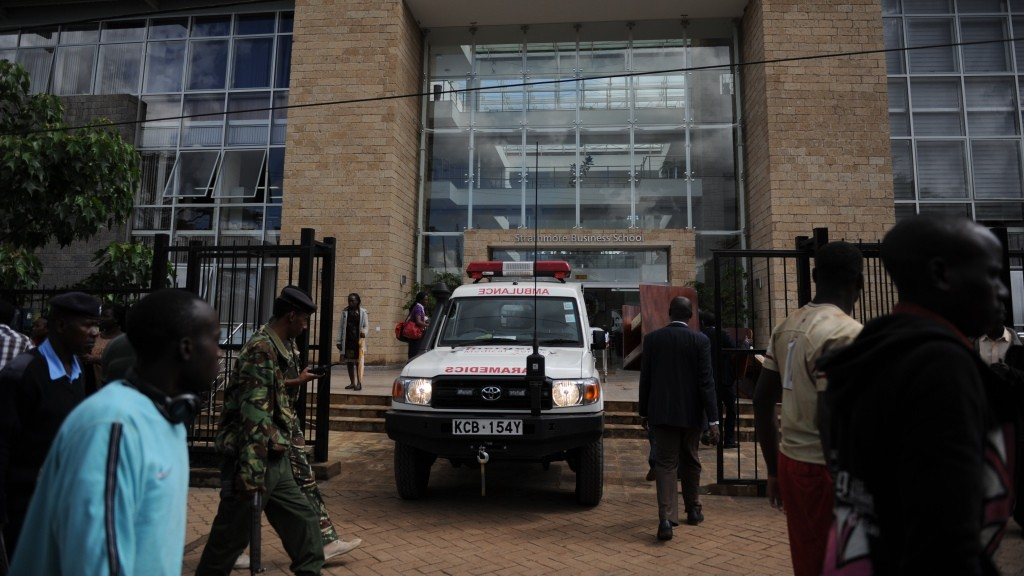 An ambulance is parked outside Strathmore University on November 30, 2015. More than 14 students  were injured  after trying to escape from the University campus  building  during an emergency drill.  Witnesses say they heard the blasts and several gunshots which made students run and take cover. In the process several students were injured. Some students were reported to have jumped from the fourth floor of their classroom building. AFP PHOTO/JOHN MUCHUCHA / AFP / John Muchucha