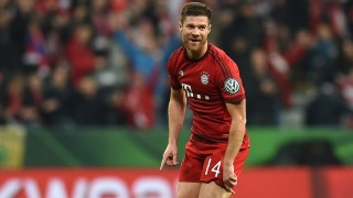 Spanish midfielder Xabi Alonso celebrates the first goal during the German Cup DFB Pokal third round match between FC Bayern Munich and SV Darmstadt 98 in Munich on December 15, 2015.  / AFP / Christof STACHE / RESTRICTIONS: ACCORDING TO DFB RULES IMAGE SEQUENCES TO SIMULATE VIDEO IS NOT ALLOWED DURING MATCH TIME. MOBILE (MMS) USE IS NOT ALLOWED DURING AND FOR FURTHER TWO HOURS AFTER THE MATCH. == RESTRICTED TO EDITORIAL USE == FOR MORE INFORMATION CONTACT DFB DIRECTLY AT +49 69 67880   /