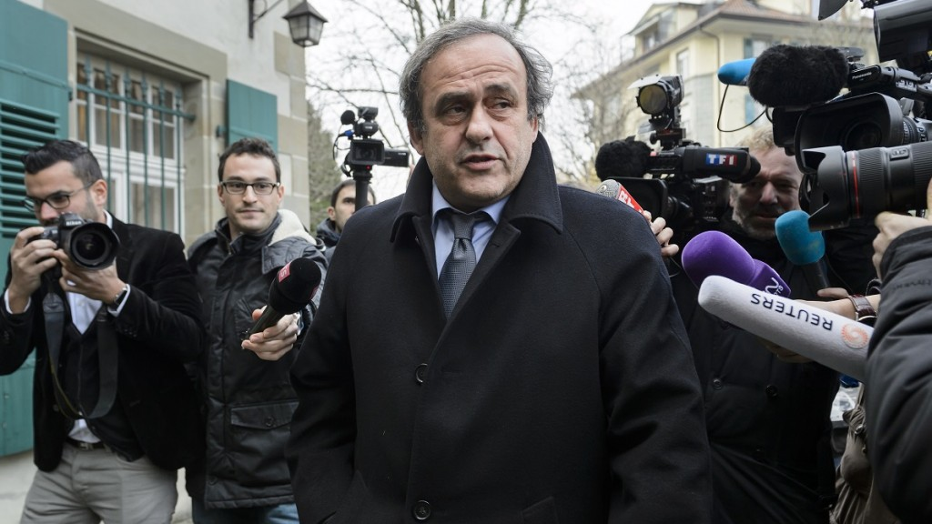 (FILES) This file photo taken on December 8, 2015 shows journalists surrounding UEFA president and FIFA vice president Michel Platini as he arrives at the Court of Arbitration for Sport (CAS) to appeal against a 90-day suspension in Lausanne. The FIFA ethics committee in Zurich will hear on December 18, 2015 the case of suspended vice president Michel Platini, but the UEFA chief, who risks a life ban from football, has said he will boycott the tribunal, accusing the committee of deciding his verdict in advance. / AFP / FABRICE COFFRINI