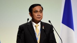 """Thailand's Prime Minister Prayuth Chan-Ocha delivers a speech during the opening day of the World Climate Change Conference 2015 (COP21), on November 30, 2015 at Le Bourget, on the outskirts of the French capital Paris. World leaders opened an historic summit in the French capital with """"the hope of all of humanity"""" laid on their shoulders as they sought a deal to tame calamitous climate change. AFP PHOTO / ALAIN JOCARD / AFP / ALAIN JOCARD"""
