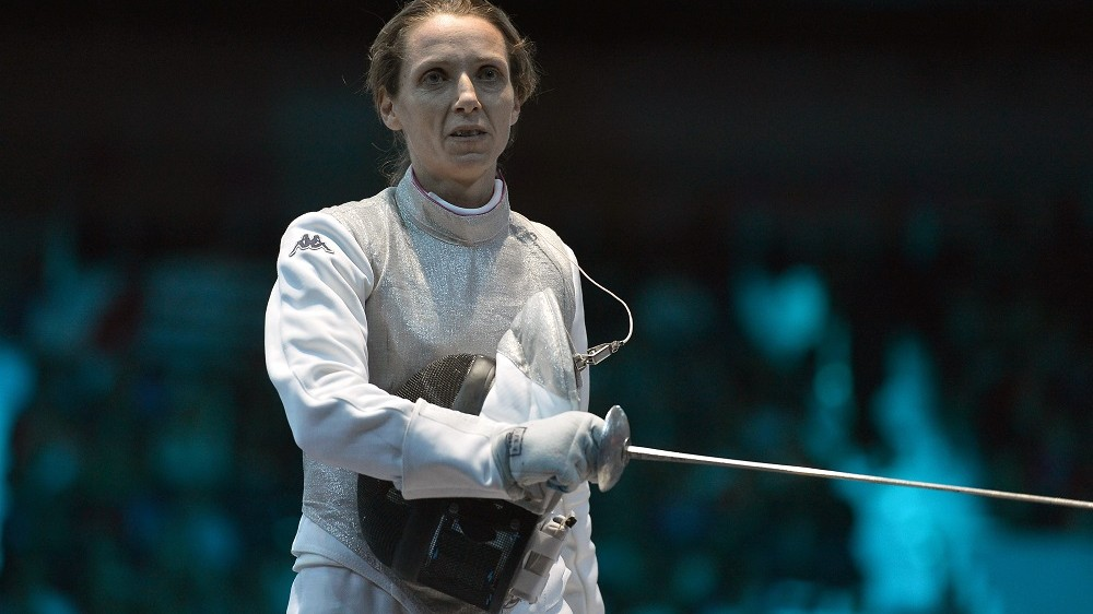 Italy's Valentina Vezzali reacts during the women's foil team semi-finals as part of the fencing event of London 2012 Olympic games, on August 2, 2012 at the ExCel centre in London. AFP PHOTO / ALBERTO PIZZOLI / AFP / ALBERTO PIZZOLI