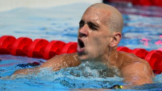 Hungary's Laszlo Cseh leaves the pool after the preliminary heats of the men's 100m butterfly swimming event at the 2015 FINA World Championships in Kazan on August 7, 2015.  AFP PHOTO / ALEXANDER NEMENOV / AFP / ALEXANDER NEMENOV