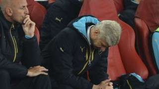Arsenal's French manager Arsene Wenger (R) and assistant manager Steve Bould (L) reacts as they watch the action from the dug out during the UEFA Champions League Group F football match between Arsenal and Olympiakos at The Emirates Stadium in north London on September 29, 2015. AFP PHOTO / GLYN KIRK / AFP / GLYN KIRK