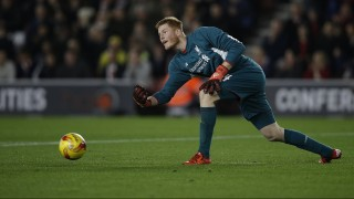 Liverpool's Hungarian goalkeeper Adam Bogdan rolls the ball to a teammate during the English League Cup quarter-final football match between Southampton and Liverpool at St Mary's Stadium in Southampton, southern England on December 2, 2015.   AFP PHOTO / ADRIAN DENNIS  RESTRICTED TO EDITORIAL USE. No use with unauthorized audio, video, data, fixture lists, club/league logos or 'live' services. Online in-match use limited to 75 images, no video emulation. No use in betting, games or single club/league/player publications. / AFP / ADRIAN DENNIS