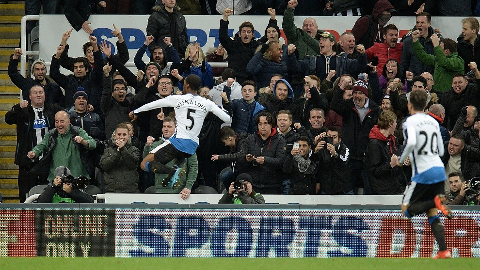 Newcastle United's Dutch midfielder Georginio Wijnaldum (L) celebrates scoring his team's second goal during the English Premier League football match between Newcastle United and Liverpool at St James' Park in Newcastle-upon-Tyne, north east England, on December 6, 2015. Newcastle won the match 2-0.    AFP PHOTO / OLI SCARFF  RESTRICTED TO EDITORIAL USE. No use with unauthorized audio, video, data, fixture lists, club/league logos or 'live' services. Online in-match use limited to 75 images, no video emulation. No use in betting, games or single club/league/player publications. / AFP / OLI SCARFF