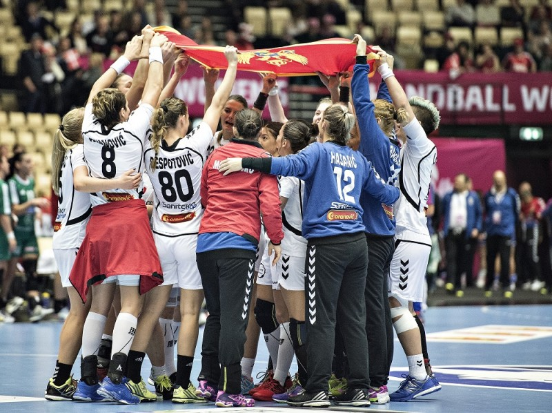 RESTRICTED TO EDITORIAL USE  Players from Montenegro celebrate after victory in the World Women's Handball Championship group A match between Montenegro and Hungary in Herning, Denmark, on December 8, 2015. AFP PHOTO / SCANPIX DENMARK / Henning Bagger ++DENMARK OUT / AFP / SCANPIX DENMARK / HENNING BAGGER