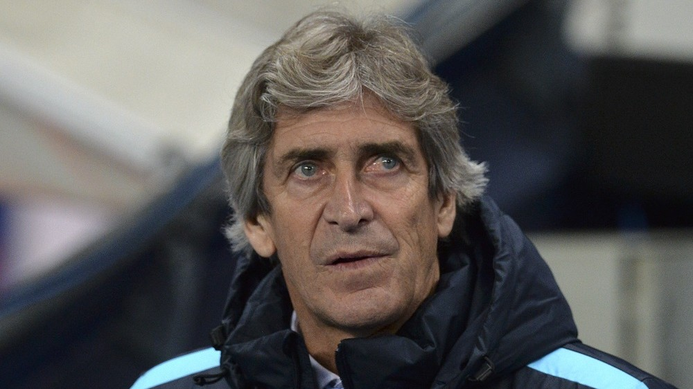 Manchester City's Chilean manager Manuel Pellegrini waits for kick off of the UEFA Champions League Group D football match between Manchester City and Borussia Moenchengladbach at the Etihad Stadium in Manchester, northwest England, on December 8, 2015.  AFP PHOTO / PAUL ELLIS / AFP / PAUL ELLIS
