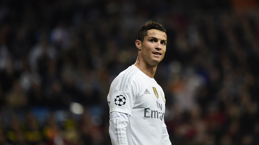 Real Madrid's Portuguese forward Cristiano Ronaldo smiles during the UEFA Champions League Group A football match Real Madrid CF vs Malmo FF at the Santiago Bernabeu stadium in Madrid on December 8, 2015.    / AFP / PIERRE-PHILIPPE MARCOU