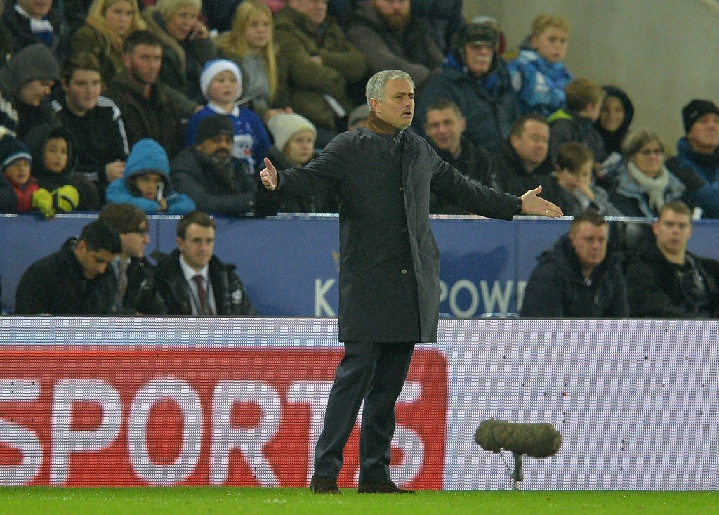 Chelsea's Portuguese manager Jose Mourinho gestures during the English Premier League football match between Leicester City and Chelsea at the King Power Stadium in Leicester, central England on December 14, 2015.  AFP PHOTO / PAUL ELLIS RESTRICTED TO EDITORIAL USE. No use with unauthorized audio, video, data, fixture lists, club/league logos or 'live' services. Online in-match use limited to 75 images, no video emulation. No use in betting, games or single club/league/player publications. / AFP / PAUL ELLIS