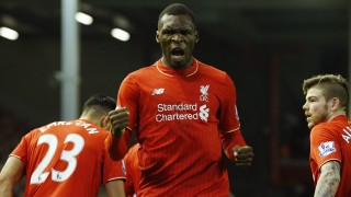 Liverpool's Zaire-born Belgian striker Christian Benteke (C) celebrates scoring the opening goal of during the English Premier League football match between Liverpool and Leicester City at the Anfield stadium in Liverpool, north-west England on December 26, 2015.  AFP PHOTO / LINDSEY PARNABY  RESTRICTED TO EDITORIAL USE. No use with unauthorized audio, video, data, fixture lists, club/league logos or 'live' services. Online in-match use limited to 75 images, no video emulation. No use in betting, games or single club/league/player publications. / AFP / LINDSEY PARNABY
