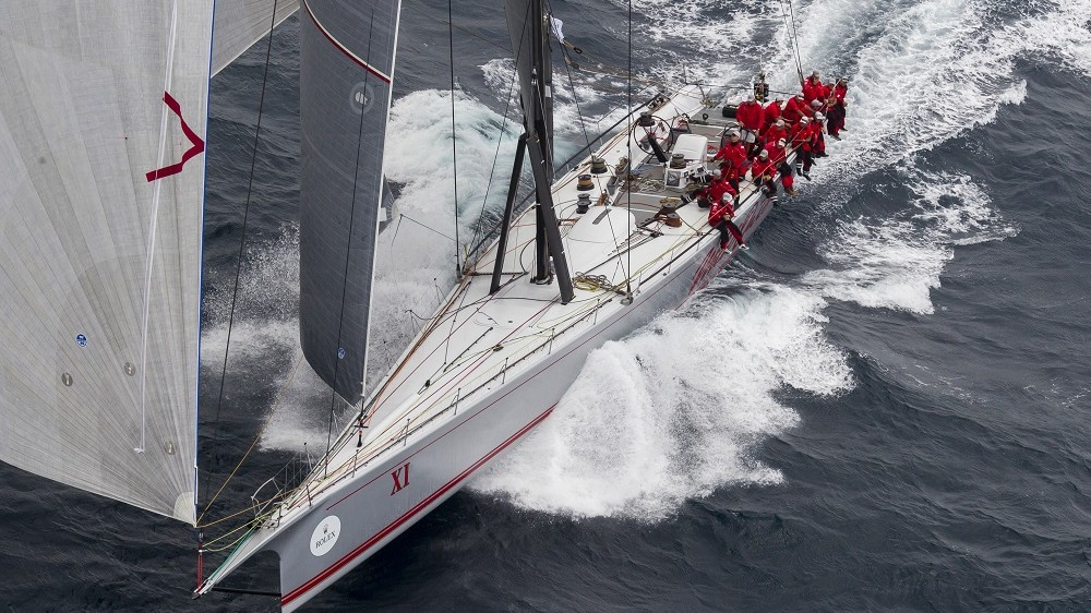 """This handout photo taken and released by Rolex on December 26, 2015 shows supermaxi yacht Wild Oats XI competing in the Sydney to Hobart yacht race in Sydney harbour.      AFP PHOTO / ROLEX / STEFANO GATTINI      IMAGE RESTRICTED TO EDITORIAL USE - STRICTLY NO COMMERCIAL USE     ----EDITORS NOTE ----RESTRICTED TO EDITORIAL USE MANDATORY CREDIT """" AFP PHOTO / ROLEX / STEFANO GATTINI"""" NO MARKETING NO ADVERTISING CAMPAIGNS - DISTRIBUTED AS A SERVICE TO CLIENTS - NO ARCHIVES / AFP / ROLEX / STEFANO GATTINI"""